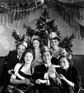 "England. 1950. ""Picturegoer"" film stars Christmas Party. Pictured enjoying the festivities are L-R: Derek Farr, Helen Cherry, Joan Greenwood, Richard Todd, Audrey Hepburn, and Phyllis Calvert."